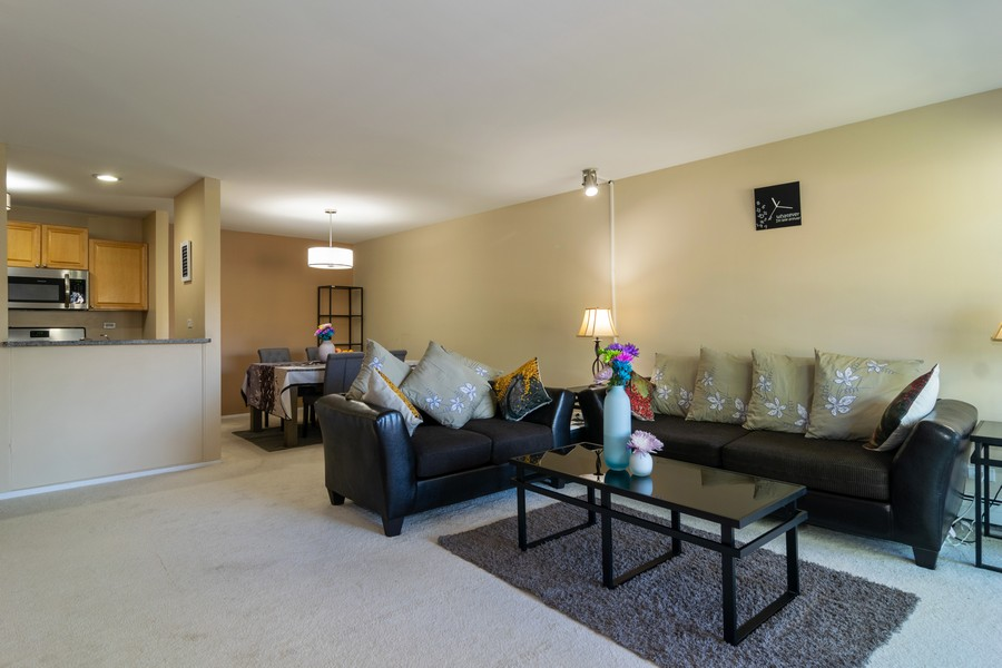 Real Estate Photography - 1931 Prairie Square 223, Schaumburg, IL, 60173 - Living Room / Dining Room