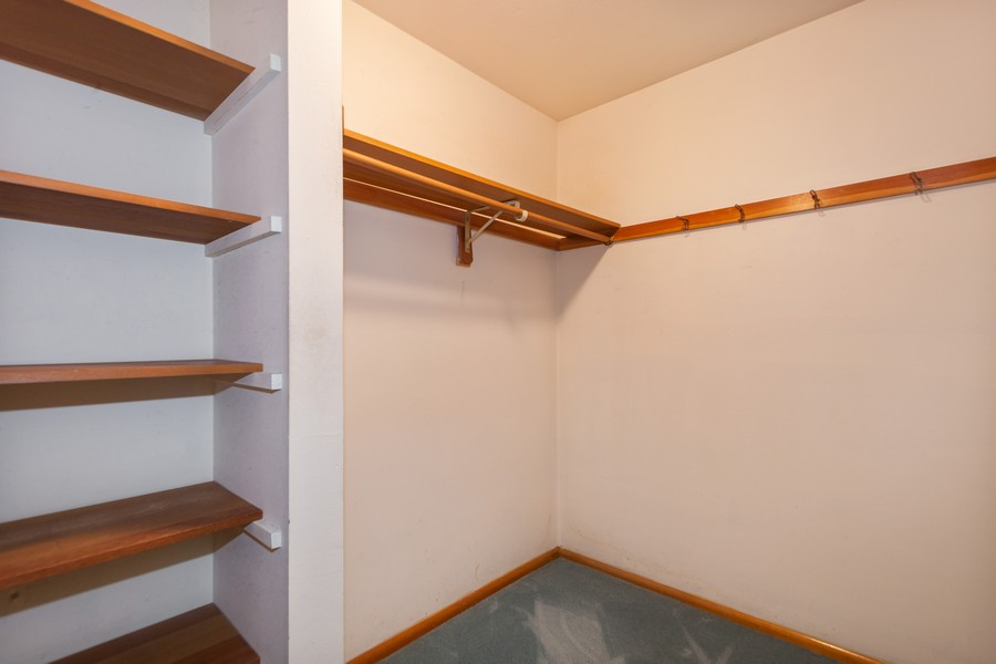 Real Estate Photography - 11919 W Locust St, Wauwatosa, WI, 53222 - Master bedroom walk-in closet