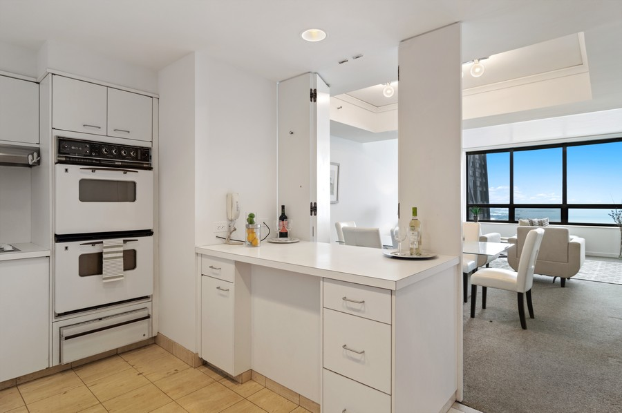 Real Estate Photography - 180 E Pearson St, Unit 4603, Chicago, IL, 60611 - Kitchen / Dining Room
