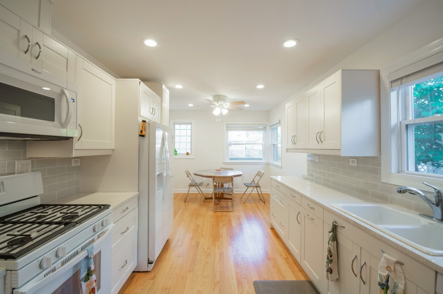 Real Estate Photography - 6963 W Balmoral Ave, CHICAGO, IL, 60656 - Kitchen / Dining Room