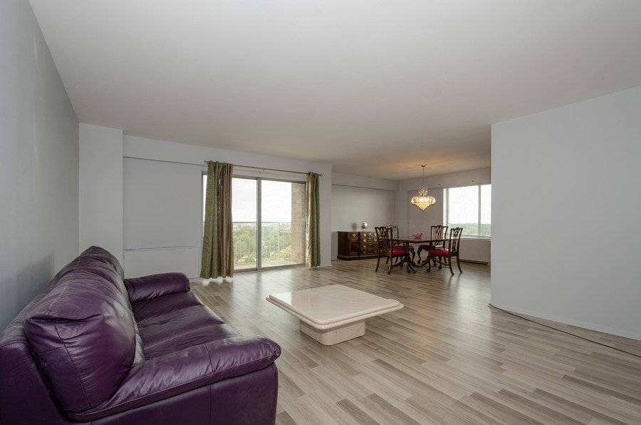 Real Estate Photography - 7141 N Kedzie, Unit 1516, Chicago, IL, 60645 - Living Room / Dining Room