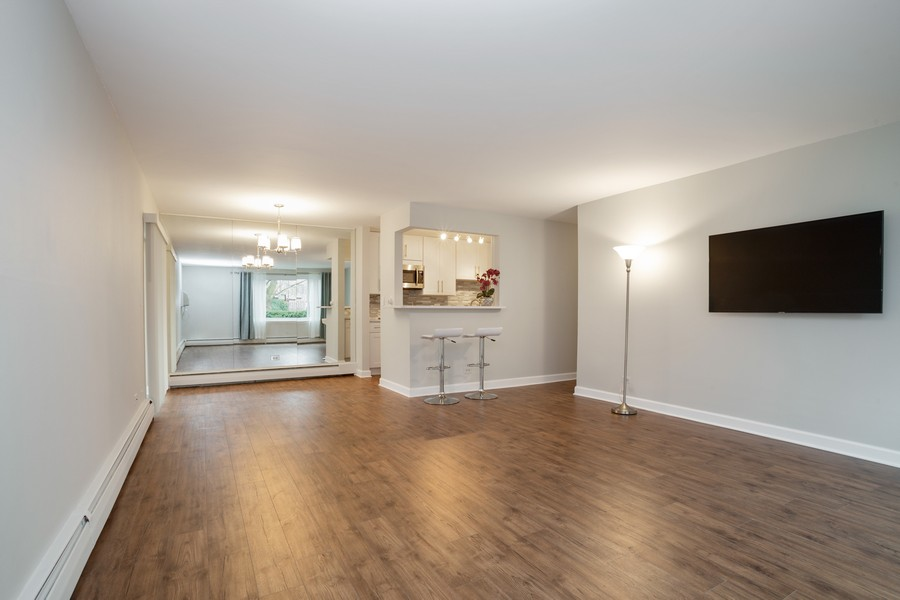 Real Estate Photography - 1116 S New Wilke Rd, Unit 109, Arlington Heights, IL, 60005 - Living Room / Dining Room