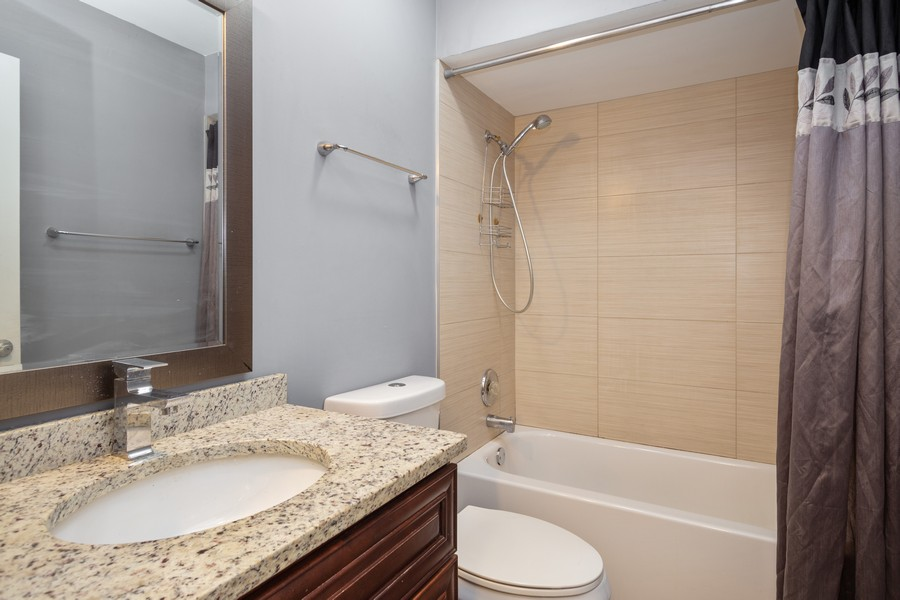 Real Estate Photography - 126 Lalomde, Unit 1C, Addison, IL, 60101 - Bathroom