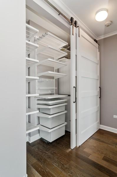 Real Estate Photography - 421 W Huron, Unit 1503, Chicago, IL, 60654 - Closet