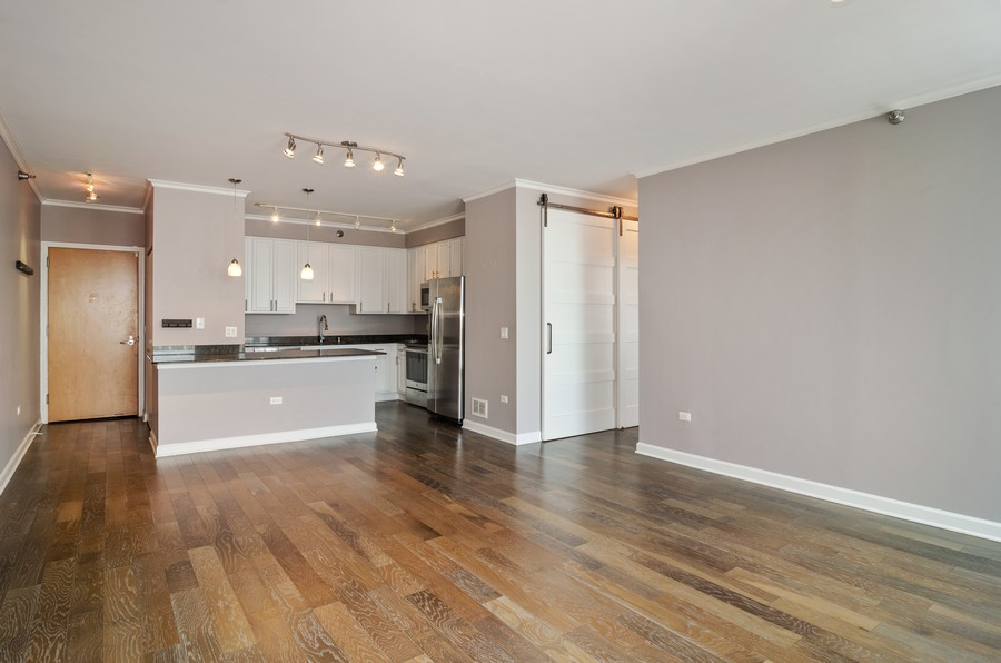 Real Estate Photography - 421 W Huron, Unit 1503, Chicago, IL, 60654 - Kitchen / Living Room