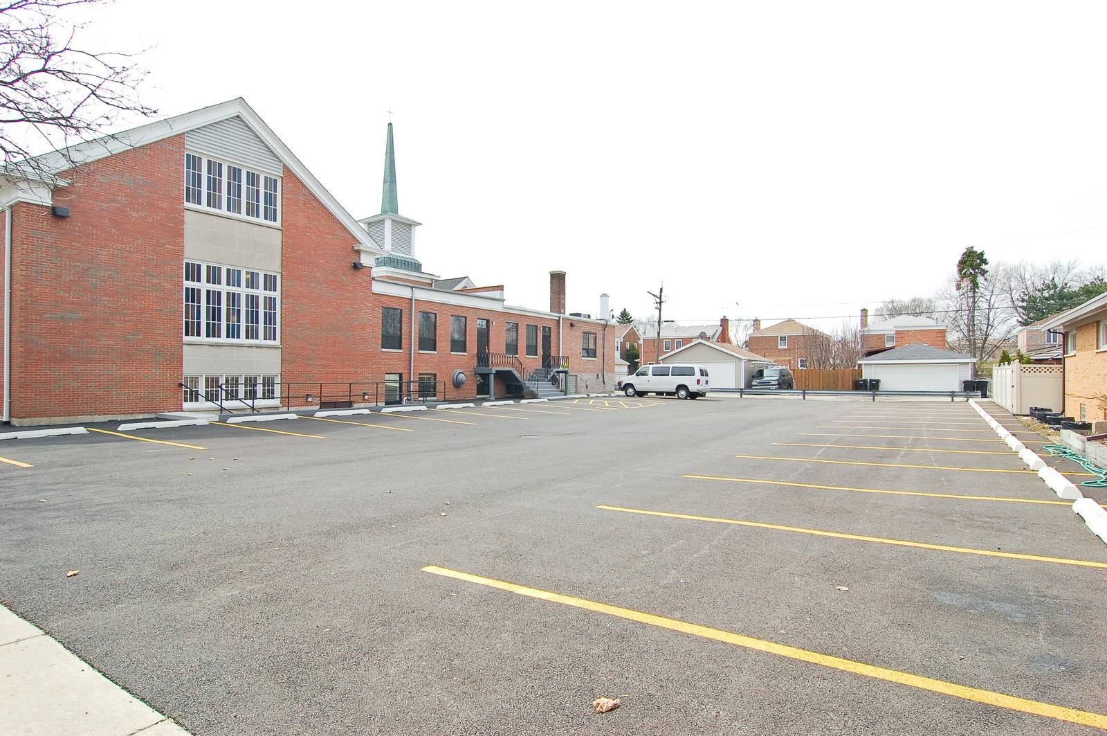 Real Estate Photography - 7534 W Berwyn Ave, Chicago, IL, 60656 - Rear View and Parking Area