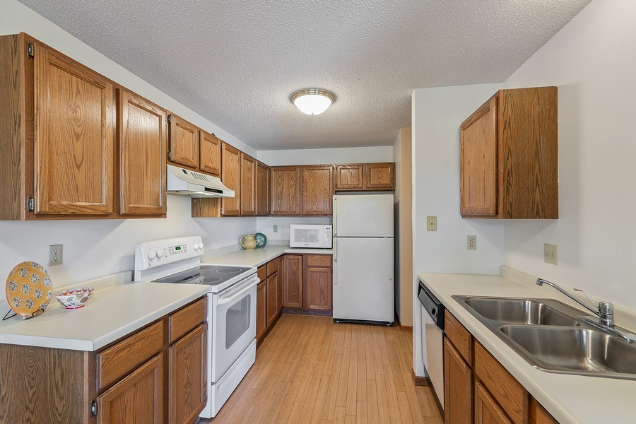 Real Estate Photography - 32 11th Ave S #303, Hopkins, MN, 55343 - Kitchen