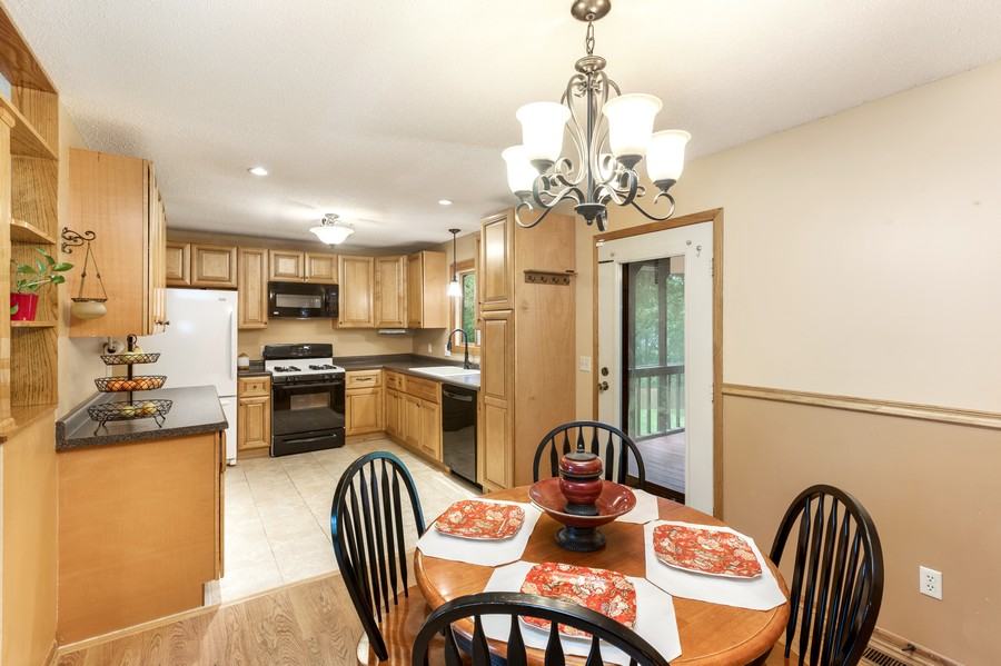 Real Estate Photography - 2069 Flanders Rd, North St Paul, MN, 55109 - Kitchen / Dining Room