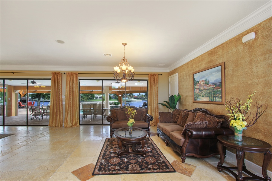 Real Estate Photography - 1930 SE 21st Ter, Cape Coral, FL, 33990 - Great Room Opens to Waterfront & Pool