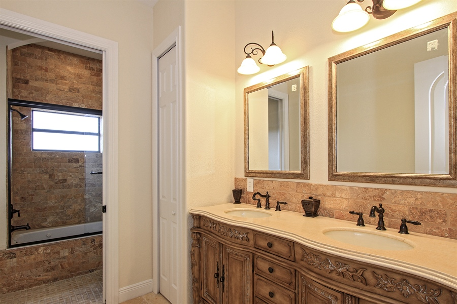 Real Estate Photography - 1930 SE 21st Ter, Cape Coral, FL, 33990 - Second floor guest bath