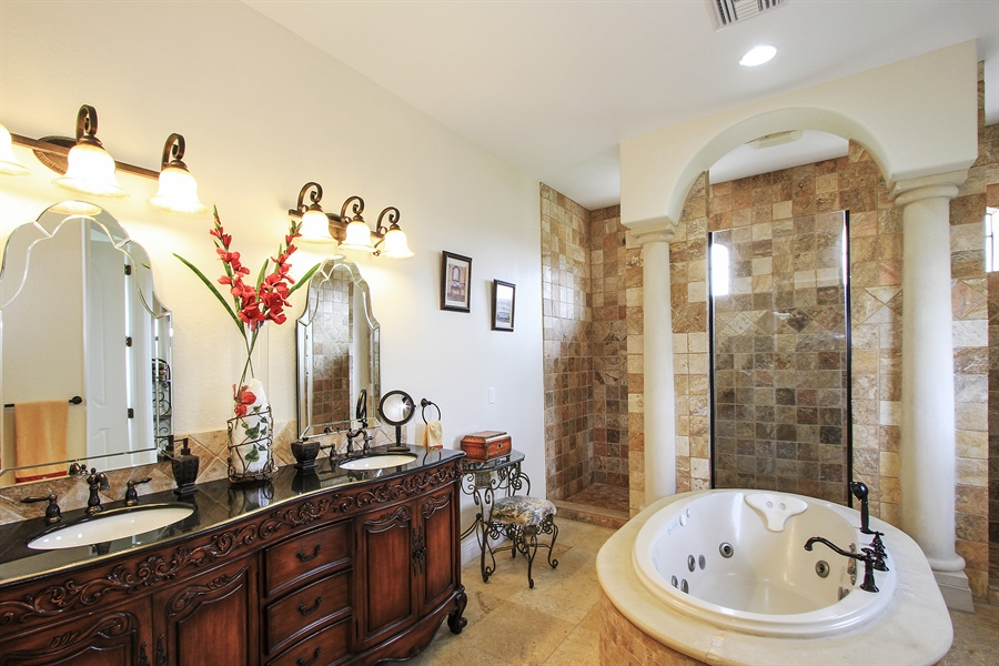 Real Estate Photography - 1930 SE 21st Ter, Cape Coral, FL, 33990 - Luxurious Master Bath with Jacuzzi & walk-through