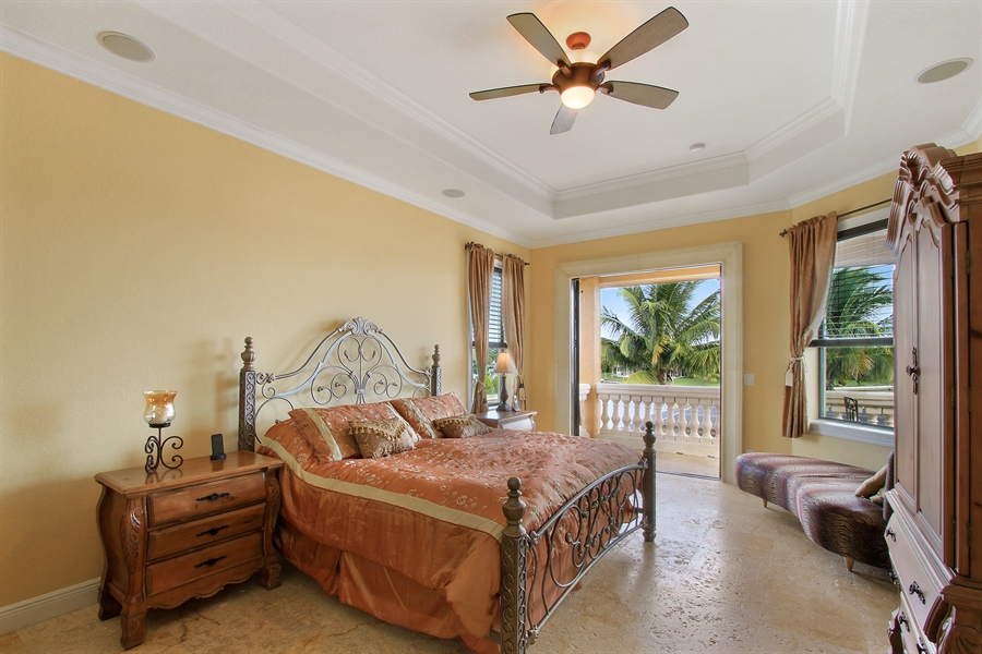 Real Estate Photography - 1930 SE 21st Ter, Cape Coral, FL, 33990 - Master Suite with balcony over looking pool & wate