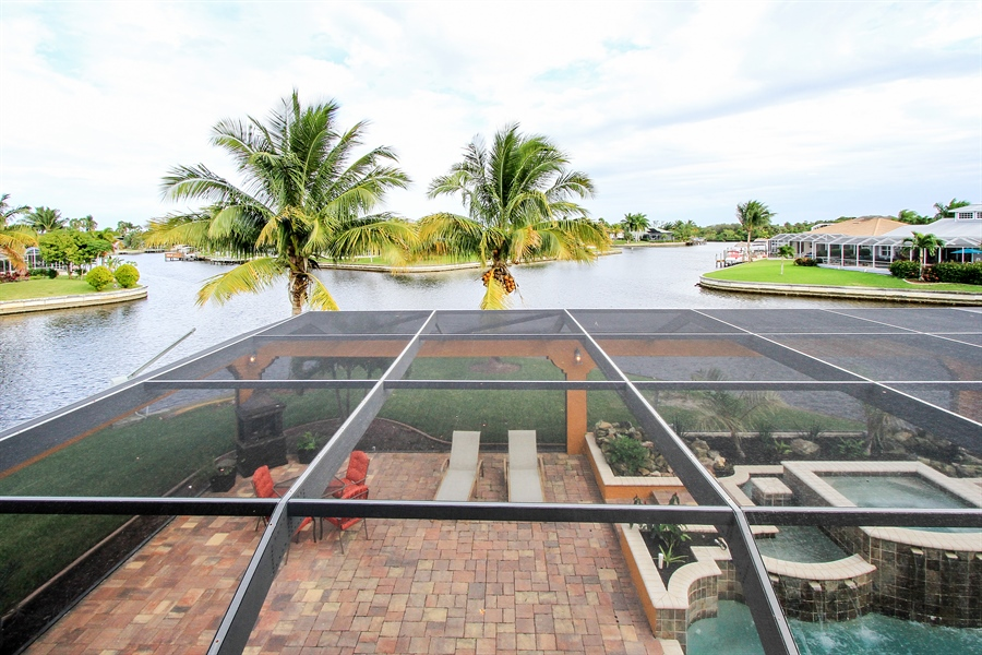 Real Estate Photography - 1930 SE 21st Ter, Cape Coral, FL, 33990 - View from the master suite balcony