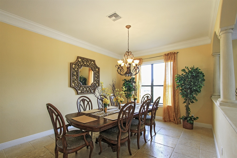 Real Estate Photography - 1930 SE 21st Ter, Cape Coral, FL, 33990 - Spacious formal dining with views of the water