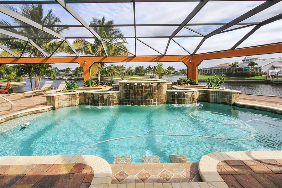 Real Estate Photography - 1930 SE 21st Ter, Cape Coral, FL, 33990 - Custom, heated pool & spa with water features
