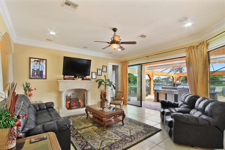 Real Estate Photography - 1930 SE 21st Ter, Cape Coral, FL, 33990 - Intimate family room near the outdoor kitchen