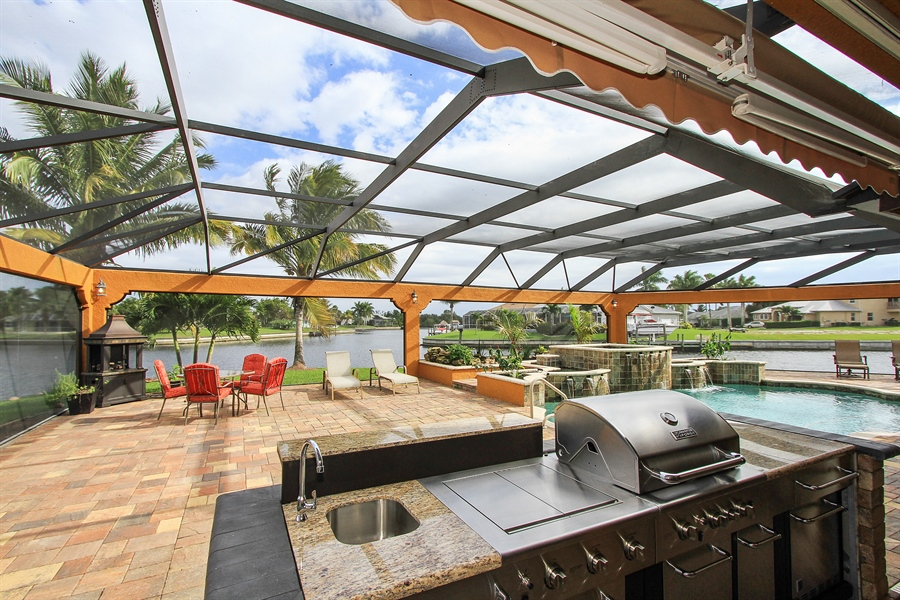 Real Estate Photography - 1930 SE 21st Ter, Cape Coral, FL, 33990 - Brand new outdoor kitchen with electric awning