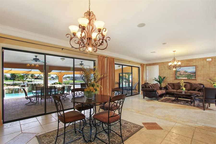 Real Estate Photography - 1930 SE 21st Ter, Cape Coral, FL, 33990 - Great room adds additional dining off the kitchen