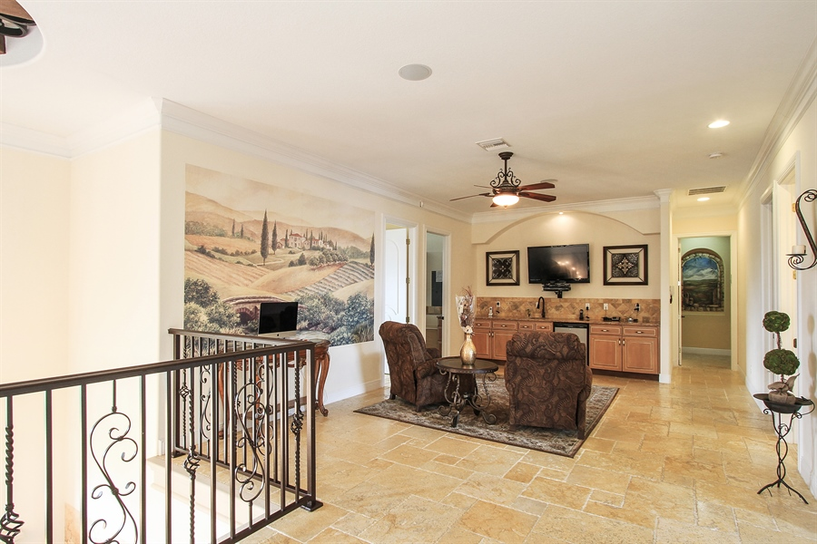 Real Estate Photography - 1930 SE 21st Ter, Cape Coral, FL, 33990 - Upper floor living space with mini kitchen adjacen