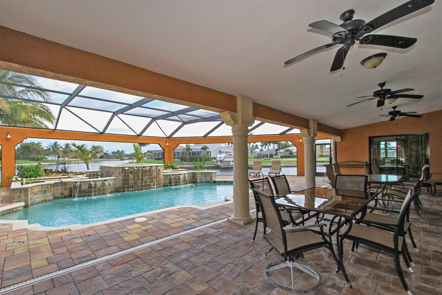 Real Estate Photography - 1930 SE 21st Ter, Cape Coral, FL, 33990 - Expansive covered, screend lanai adjacent to pool