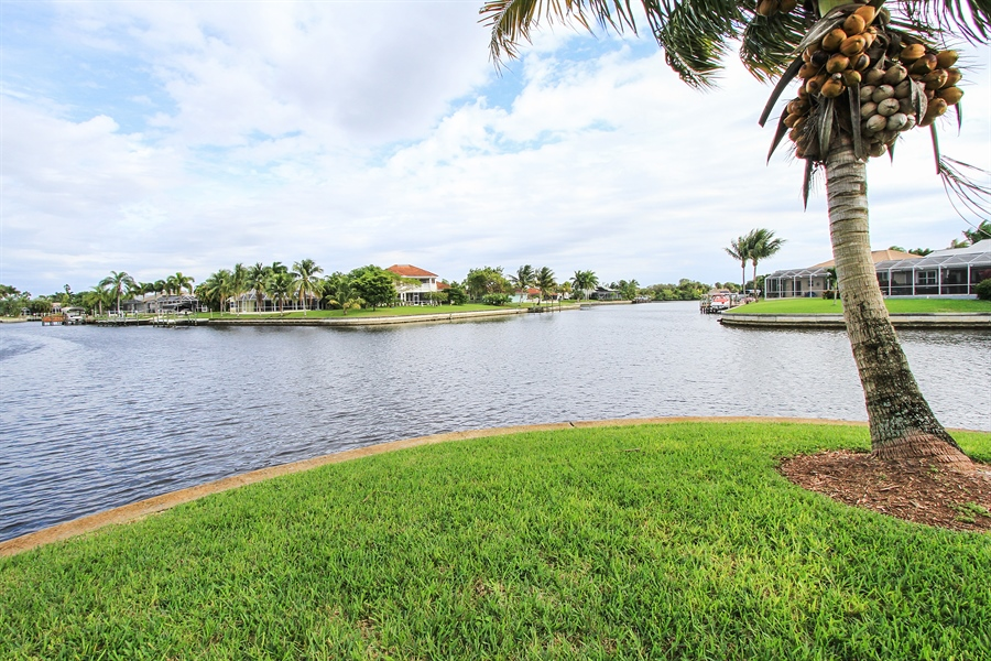 Real Estate Photography - 1930 SE 21st Ter, Cape Coral, FL, 33990 - Intersecting canal views