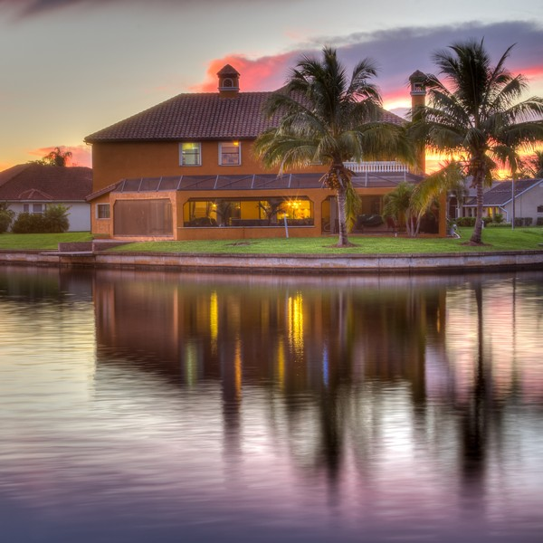 Real Estate Photography - 1930 SE 21st Ter, Cape Coral, FL, 33990 - Rear view of home at sunset