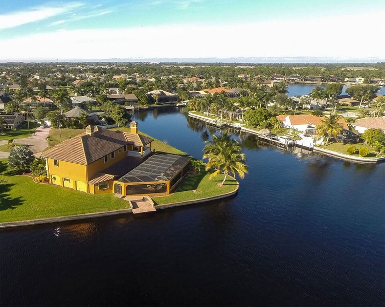 Real Estate Photography - 1930 SE 21st Ter, Cape Coral, FL, 33990 - Open basin, wide canals