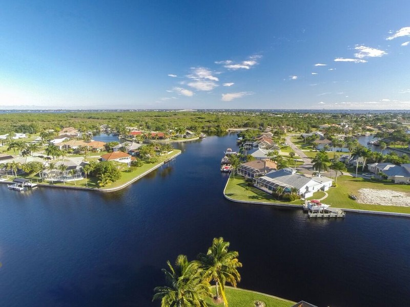Real Estate Photography - 1930 SE 21st Ter, Cape Coral, FL, 33990 - View of the Caloosahatchee River in foreground