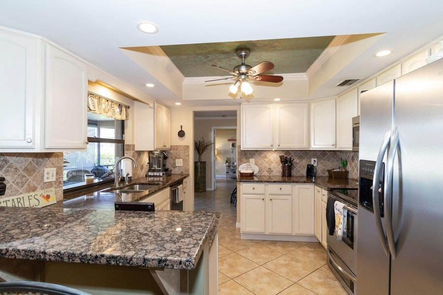 Real Estate Photography - 1518 Whiskey Creek Drive, Fort Myers, FL, 33919 - Kitchen / Breakfast Room