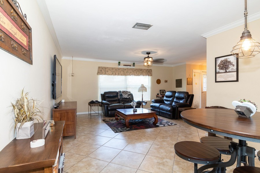 Real Estate Photography - 1518 Whiskey Creek Drive, Fort Myers, FL, 33919 - Living Room / Dining Room