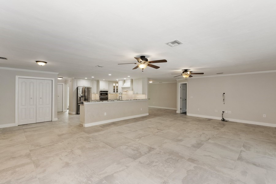 Real Estate Photography - 13502 Brynwood Lane, Ft. Myers, FL, 33912 - Family Room / Kitchen