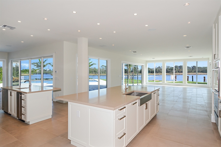 Real Estate Photography - 14490 Cypress Island Cir, Palm Beach Gardens, FL, 33410 - Family Room / Kitchen