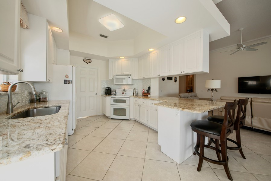 Real Estate Photography - 7729 Quida Drive, West Palm Beach, FL, 33411 - Kitchen / Living Room