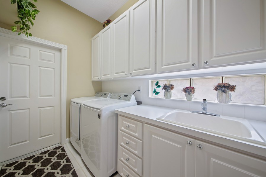 Real Estate Photography - 7706 Red River Rd, West Palm Beach, FL, 33411 - Laundry Room
