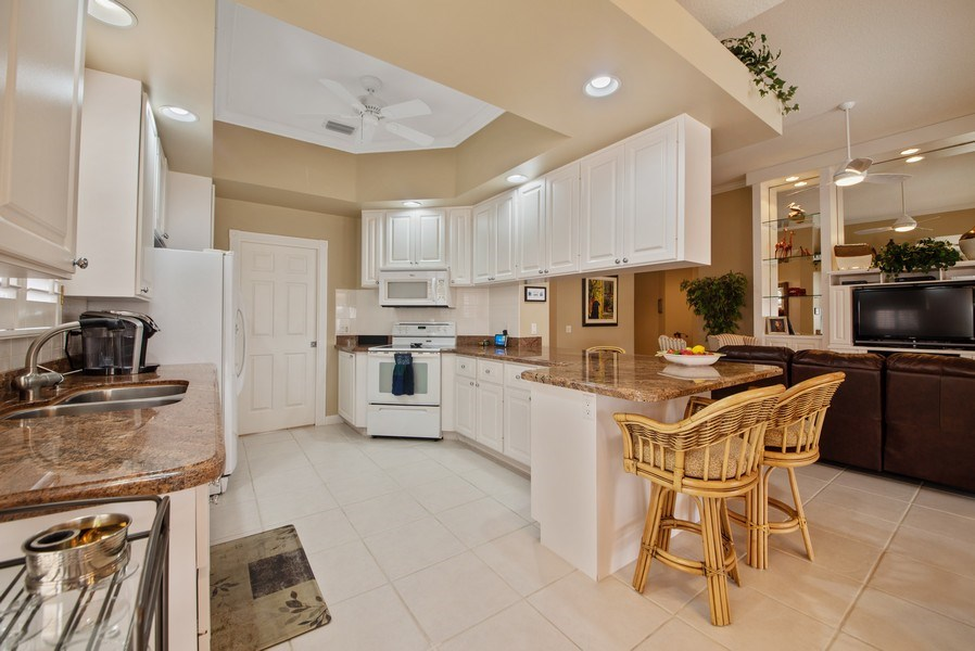 Real Estate Photography - 7706 Red River Rd, West Palm Beach, FL, 33411 - Kitchen / Living Room