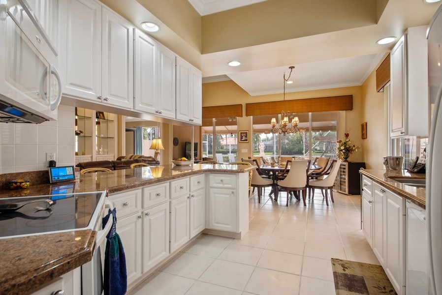 Real Estate Photography - 7706 Red River Rd, West Palm Beach, FL, 33411 - Kitchen / Dining Room
