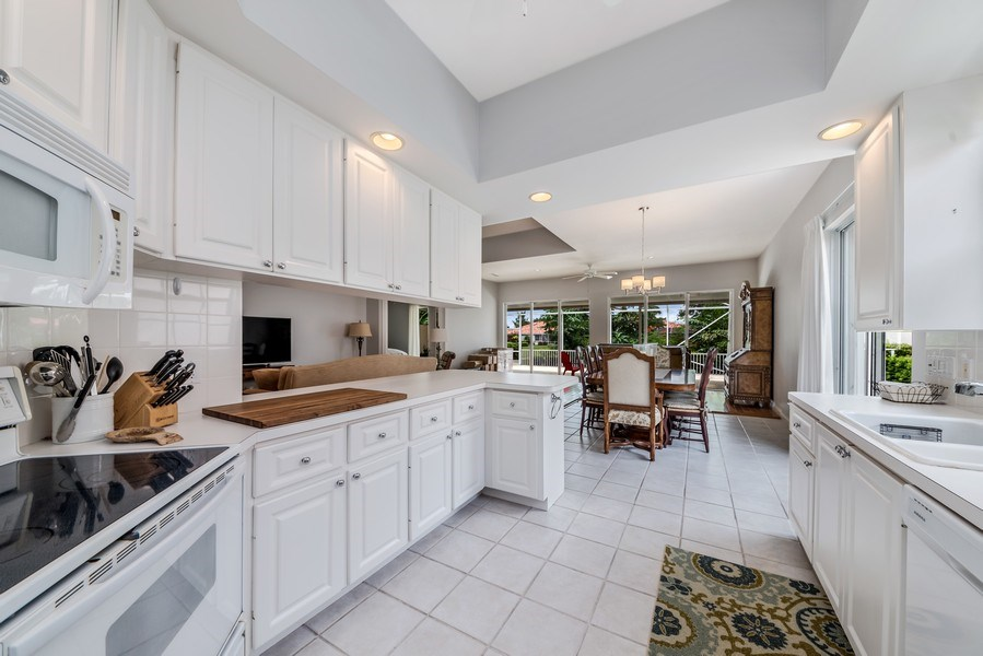 Real Estate Photography - 2733 Kittbuck Way, 403, West Palm Beach, FL, 33411 - Kitchen/Dining
