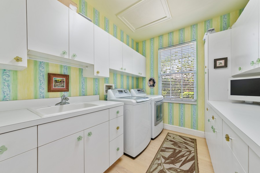 Real Estate Photography - 1314 Breakers West Blvd, West Palm Beach, FL, 33411 - Laundry Room