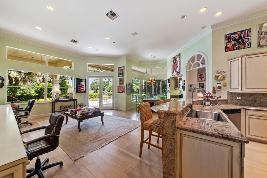 Real Estate Photography - 1314 Breakers West Blvd, West Palm Beach, FL, 33411 - Family Room / Kitchen