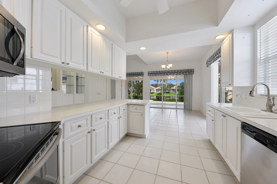 Real Estate Photography - 2847 Irma Lake Drive, West Palm Beach, FL, 33411 - Kitchen / Dining Room