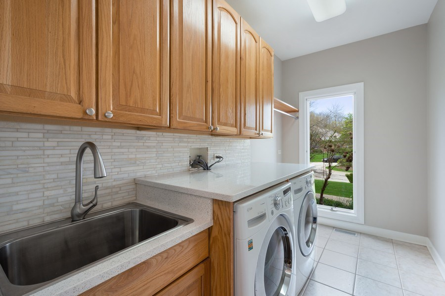Real Estate Photography - 22935 N. Woodcrest Lane, Kildeer, IL, 60047 - Main Level Laundry Room