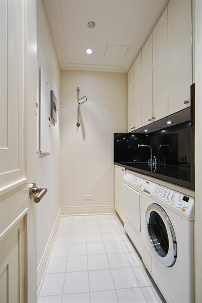 Real Estate Photography - 159 E Walton Pl, Unit 13A, Chicago, IL, 60610 - Laundry Room