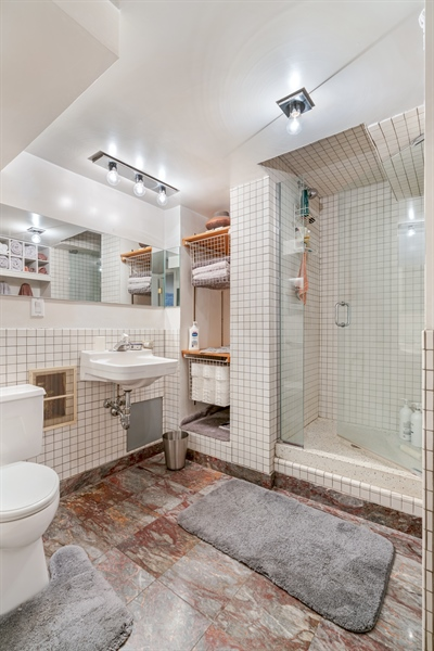 Real Estate Photography - 400 S Green St, 518, Chicago, IL, 60607 - 2nd Bathroom