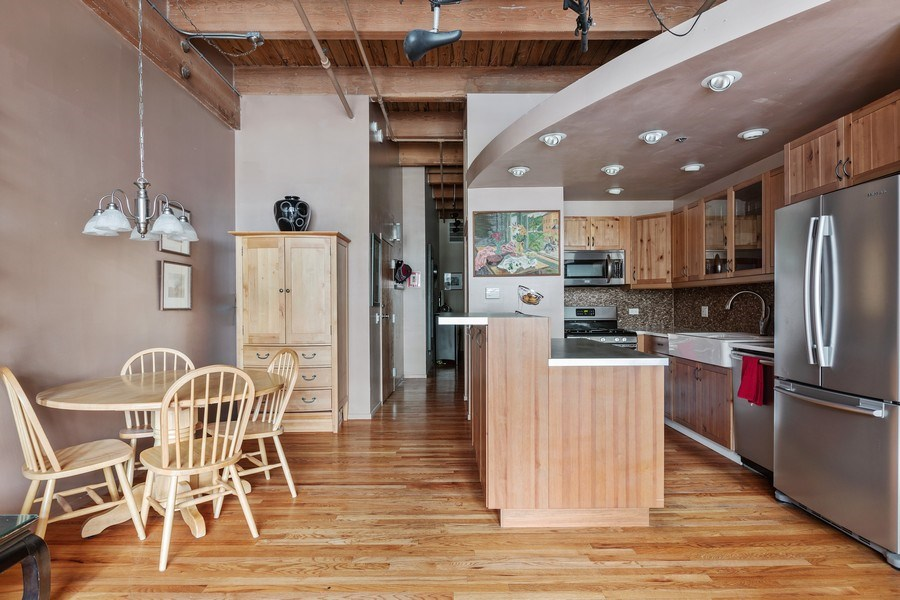 Real Estate Photography - 2300 W Wabansia Ave, 106, Chicago, IL, 60647 - Kitchen / Dining Room