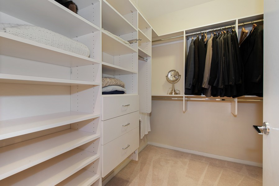 Real Estate Photography - 400 N Clinton, Unit 404, Chicago, IL, 60654 - Master Bedroom Closet