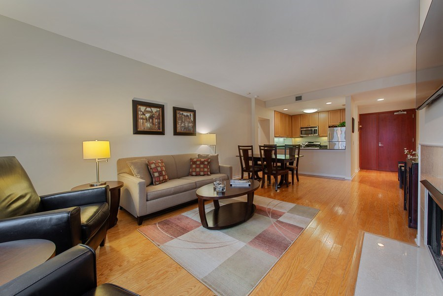 Real Estate Photography - 400 N Clinton, Unit 404, Chicago, IL, 60654 - Living/Dining/Kitchen