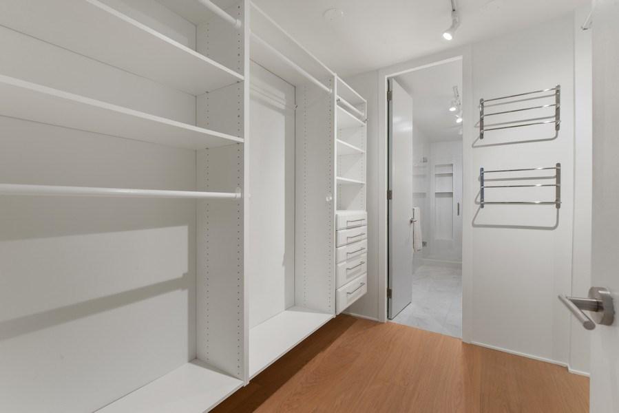 Real Estate Photography - 200 E Delaware Pl, 12D, Chicago, IL, 60611 - Master Bedroom Closet