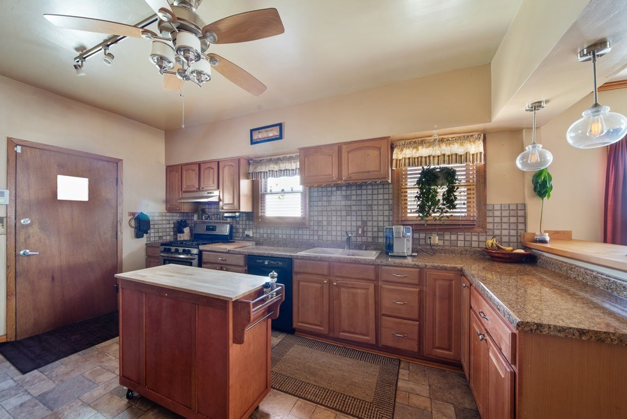 Real Estate Photography - 6952 W Wellington Ave, Chicago, IL, 60634 - Kitchen