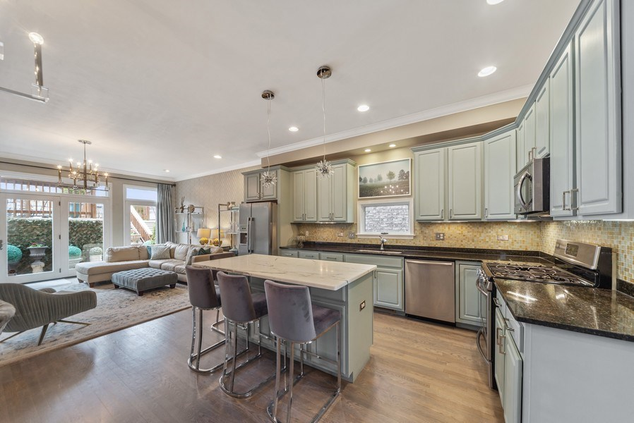 Real Estate Photography - 2339 W. Ohio ST., Chicago, IL, 60612 - Kitchen and Family Room towards Deck