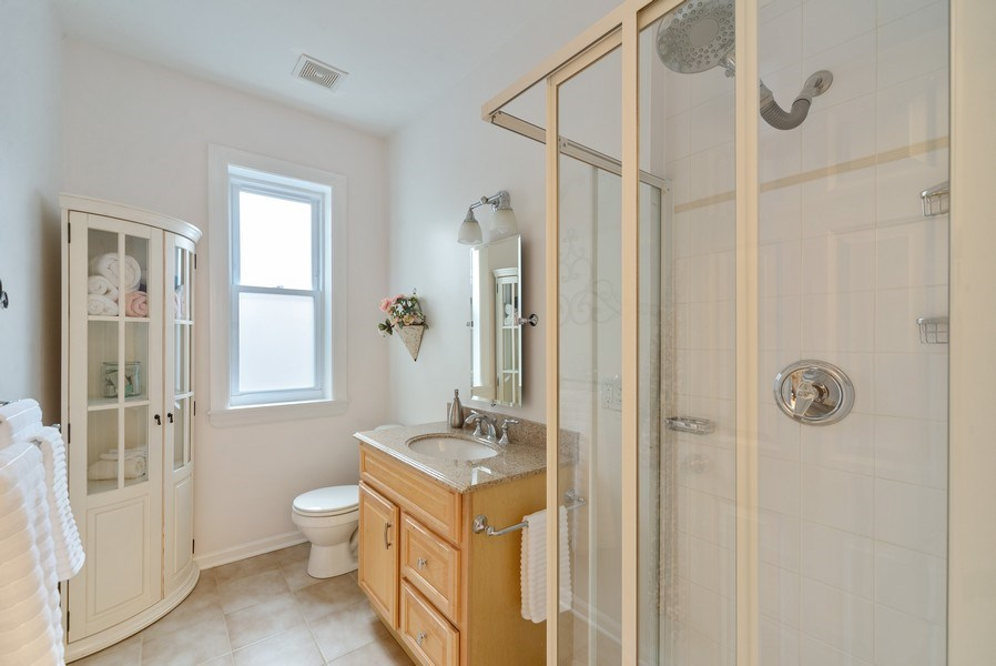 Real Estate Photography - 4639 N. Central Park, 2N, Chicago, IL, 60625 - Bathroom